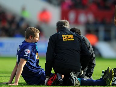 Michael Dawson of Hull City receives treatment before being taken off at Bristol City