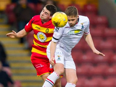 Kris Doolan goes in for the aerial challenge with Danny Devine