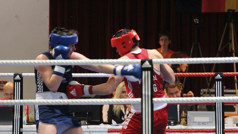 Savannah Marshall (right) battles her way to glory in Germany