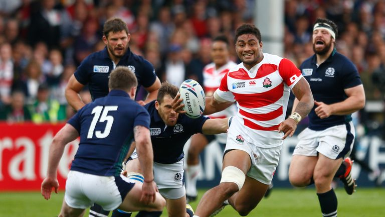 Japan's Amanaki Mafi breaks during the 2015 Rugby World Cup Pool B match between Scotland and Japan