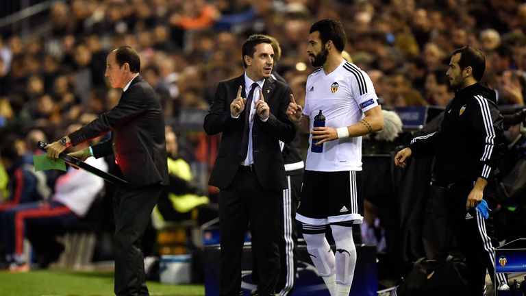 Neville gives Alvaro Negredo instructions on the sidelines
