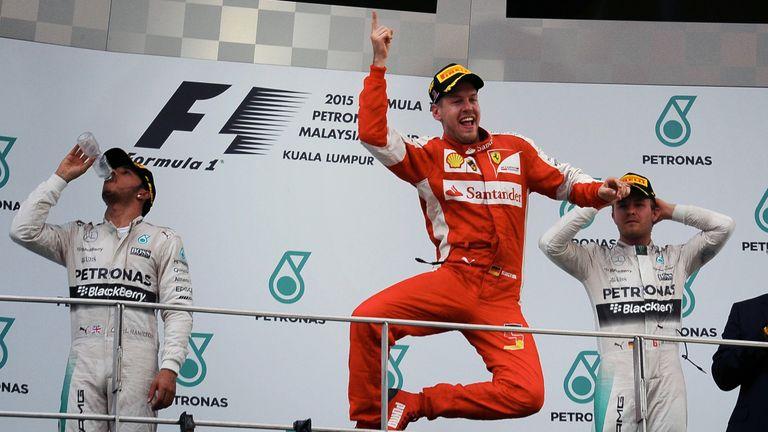 Sebastian Vettel celebrates victory in Malysia