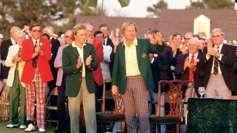 Bernhard Langer hands the Green Jacket over to Nicklaus after his victory