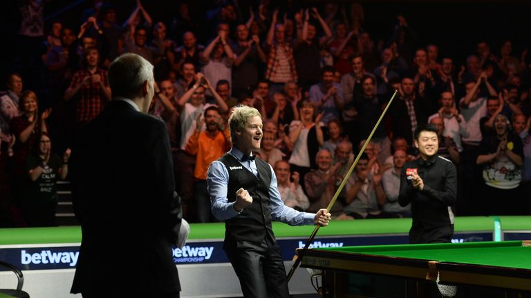 Neil Robertson celebrates his landmark moment at the Barbican Centre in York