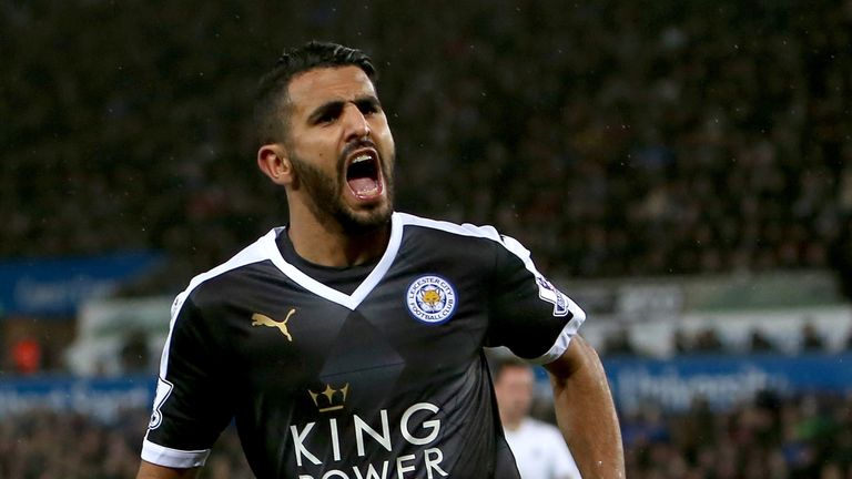 Riyad Mahrez celebrates after scoring his third goal during the English Premier League football match between Swansea City and Leicester City