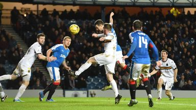 Rangers midfielder Jason Holt (centre) heads home the opening goal against Dumbarton