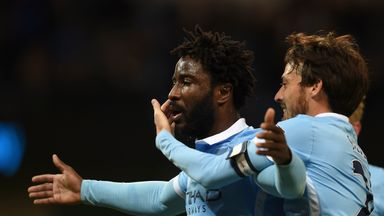 Manchester City's Ivorian striker Wilfried Bony (L) celebrates with David Silva (R)
