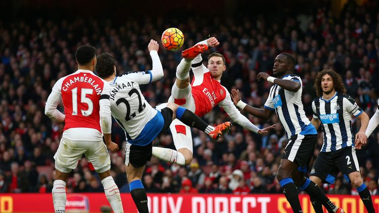 Aaron Ramsey and Daryl Janmaat compete for the ball