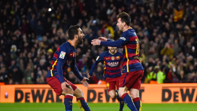 Turan (L) and Messi jump for joy after the latter's sublime free-kick had given the home side a 2-1 lead