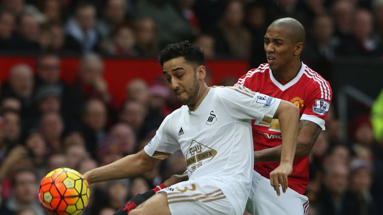 Neil Taylor holds off Ashley Young