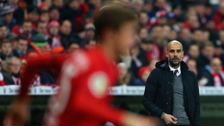 Guardiola watches his Bayern Munich side from the sidelines