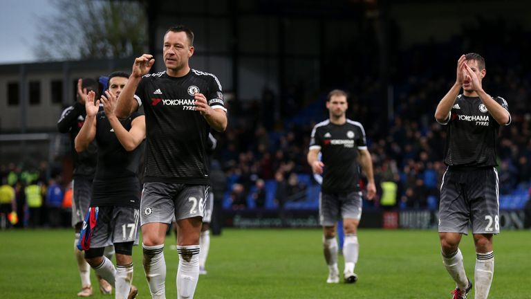 Terry and his Chelsea team-mates applaud the fans