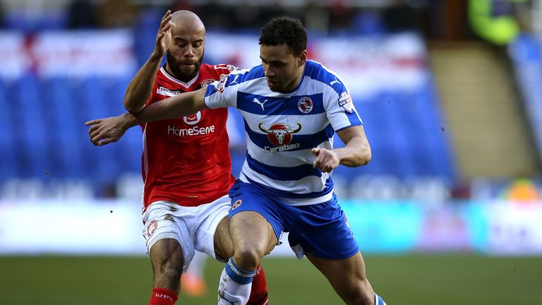 Hal Robson-Kanu holds off the challenge of Paul Downing