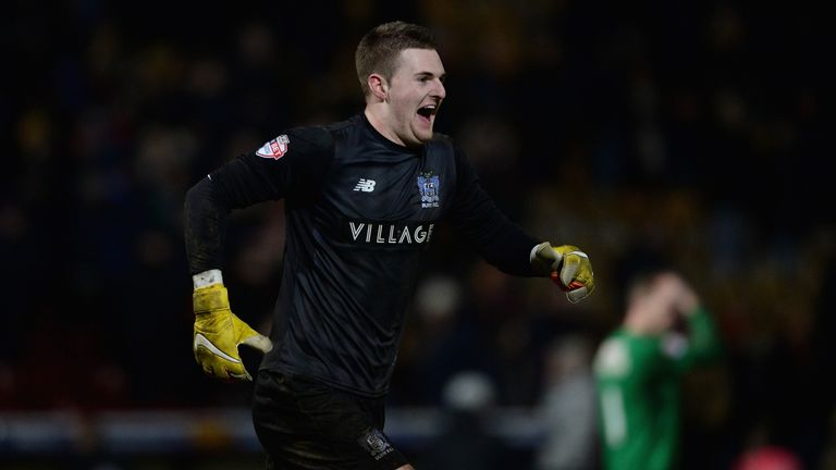 Ian Lawlor celebrates after Bury went through to the fourth round with a penalty shoot-out win over Bradford