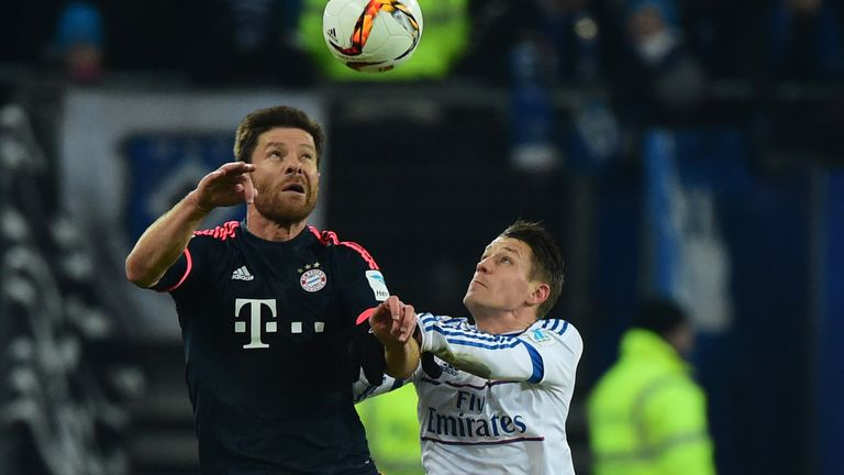 Bayern Munich's Xabi Alonso vies with Hamburg midfielder Ivo Ilicevi