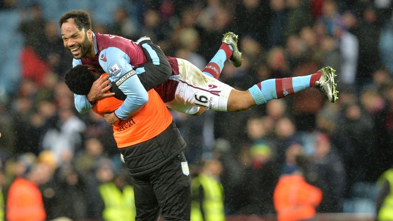 Lescott (top) celebrates after winning the match against Palace