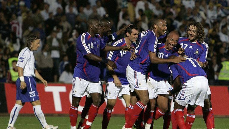 Faubert is mobbed by the likes of Thierry Henry and William Gallas after scoring on his first appearance for France in 2006