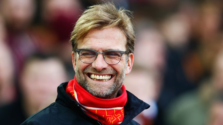 Liverpool manager Jurgen Klopp smiles on the touchline