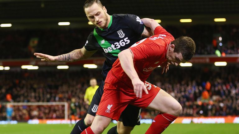 Jon Flanagan of Liverpool holds off Stoke's Marko Arnautovic