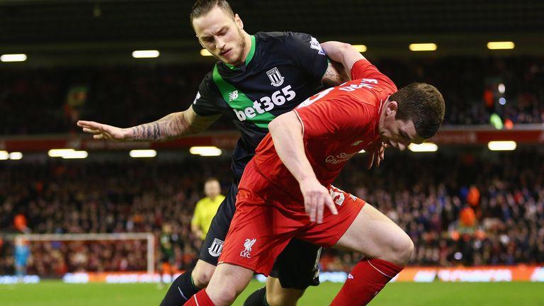 Jon Flanagan of Liverpool holds off Stoke's Marko Arnautovic