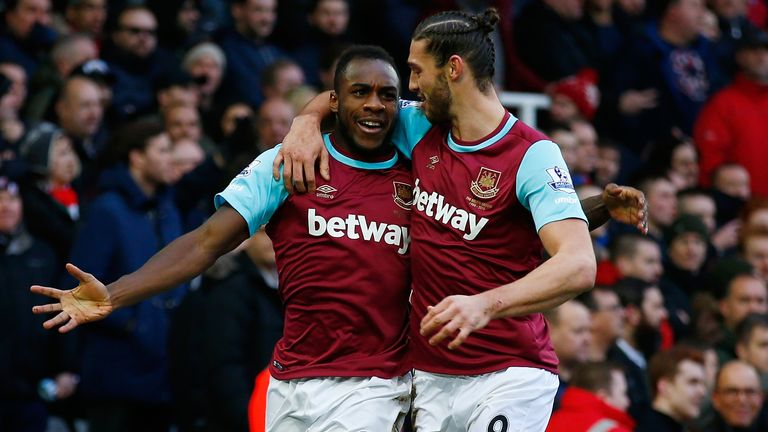 Michail Antonio celebrates with Andy Carroll after scoring against Liverpool