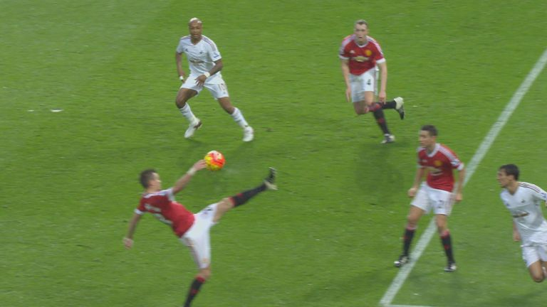 The ball hits Morgan Schneiderlin's (Manchester United) hand in the penalty area against Swansea