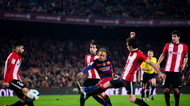Neymar fires the ball past Iago Herrerin in the final minute