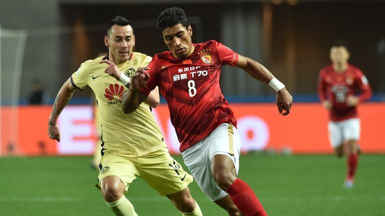 Paulinho (right) has lifted the Chinese Super League title with Guangzhou Evergrande in his first two seasons