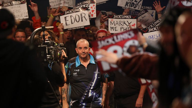 Phil Taylor takes in the support of the crowd at the Auckland Darts Masters