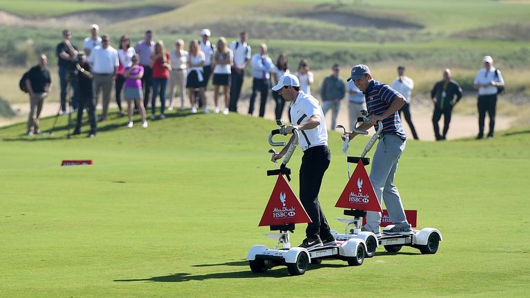 Spieth and McIlroy collided on the fairway, but both stayed on their GolfBoards