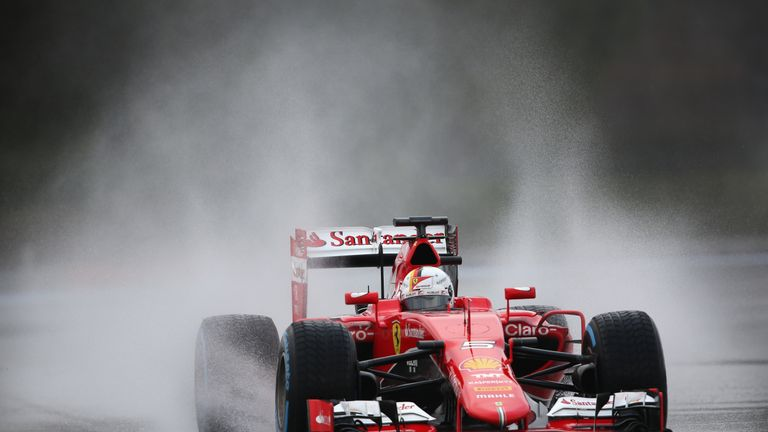 The German kicks up the spray on the artificially wet track