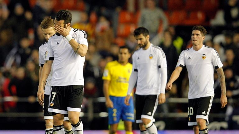 Valencia's players leave the field following the draw
