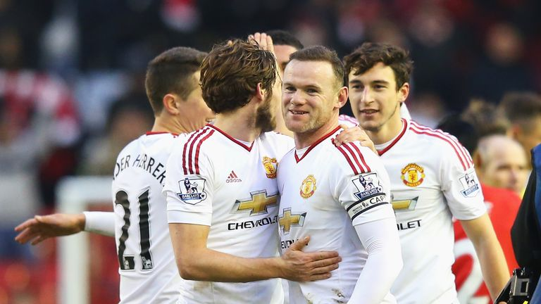 Wayne Rooney celebrates victory at Anfield with his Manchester United team-mates
