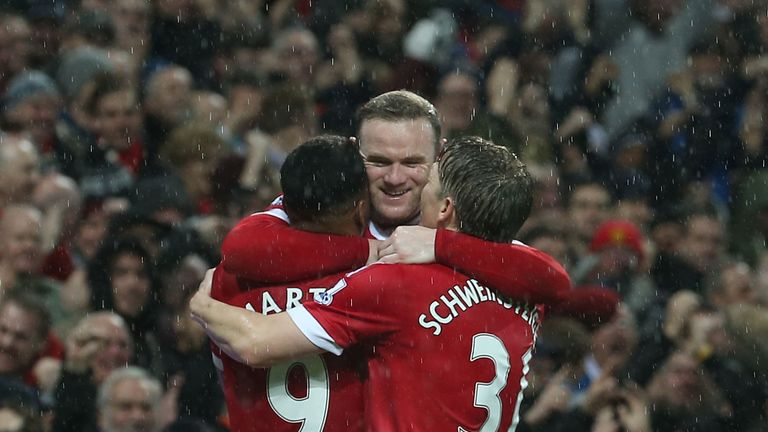 Wayne Rooney celebrates his goal against Swansea in Manchester United's 2-1 win
