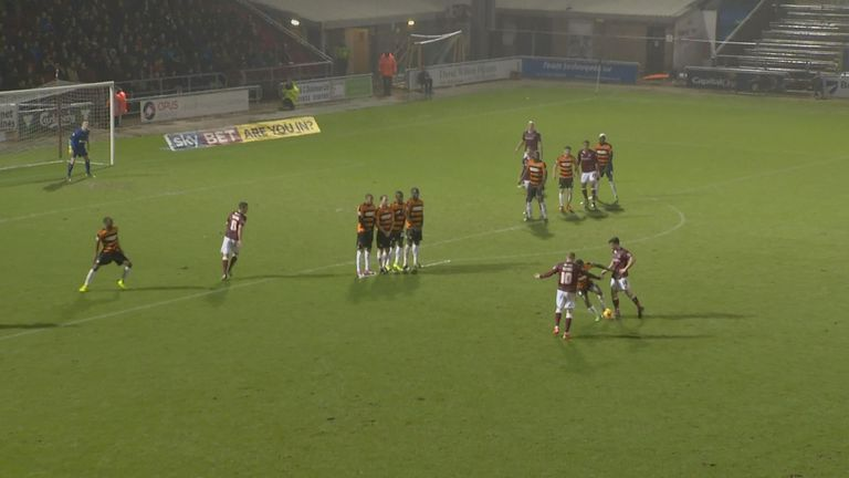 Yiadom (Barnet) believes Northampton's Gavin Hoyte has touched the ball from a free-kick, therefore runs out of the wall and kicks the ball away