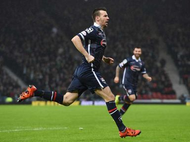 Paul Quinn celebrates his goal for Ross County
