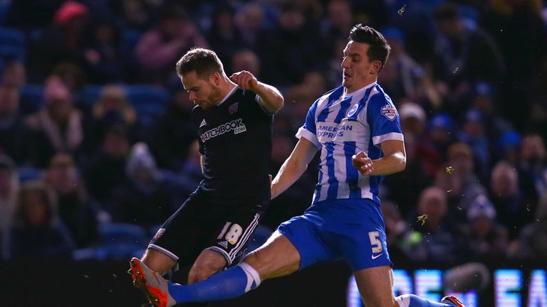 Lewis Dunk (right) slides in on Alan Judge