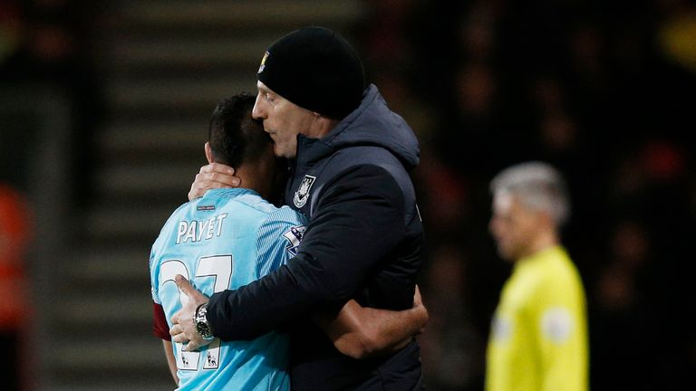 Payet is embraced by West Ham manager Bilic