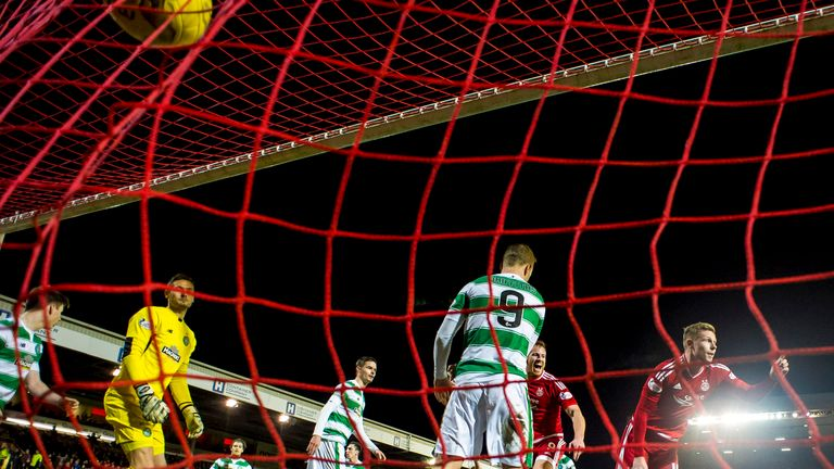 Simon Church turns the ball into the net to for his first Aberdeen goal