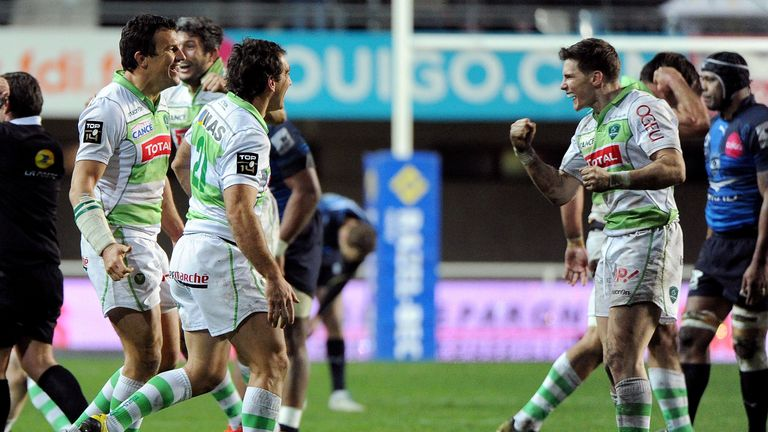 Pau's Colin Slade celebrates with team-mates after beating Montpellier