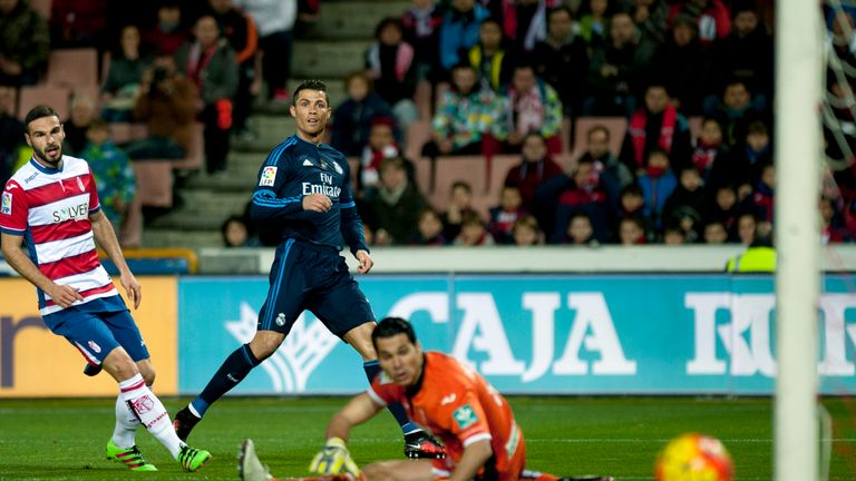 David Rodriguez Lomban and goalkeeper Andres see out a Cristiano Ronaldo effort.