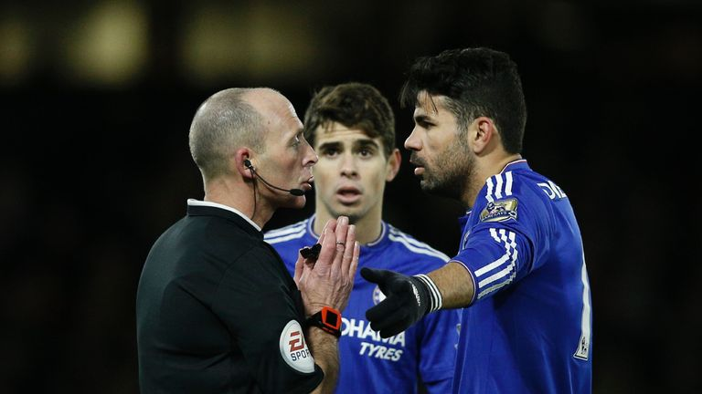 Mike Dean (left) talks with Costa (right) and Oscar in the first half