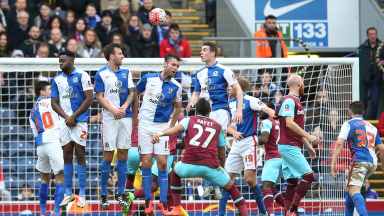 Dimitri Payet curls a free-kick over the Blackburn wall and into the net