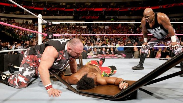 The Dudley Boyz just love putting people through tables