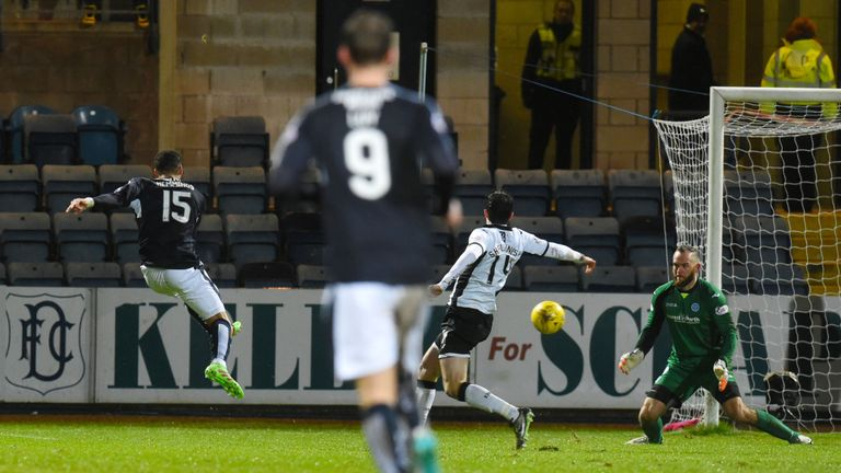 Kane Hemmings lashes home his second on a night when persistent rain lashed down at Dens Park