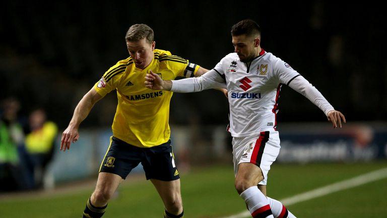 MK Dons' Jake Forster-Caskey and Middlesbrough's Grant Leadbitter battle for the ball