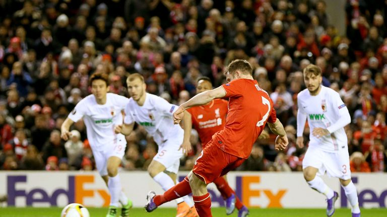 James Milner scores his side's first goal from the penalty spot
