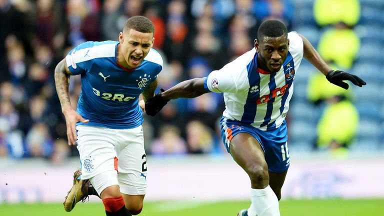 James Tavernier and Tope Obadeyi battle for possession at Ibrox