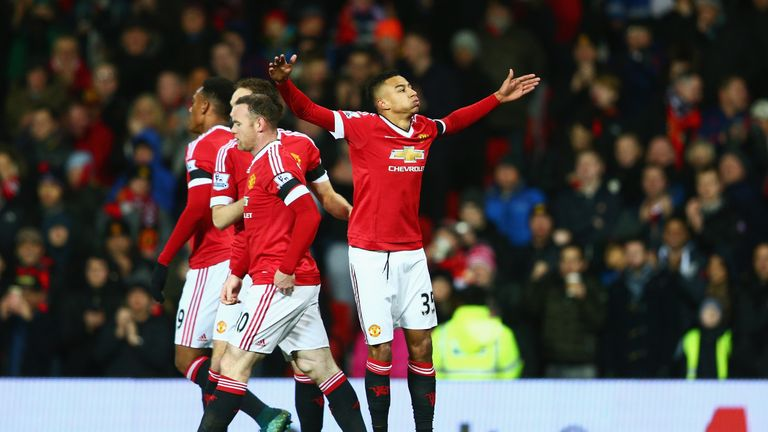 Jesse Lingard celebrates after opening the scoring for United