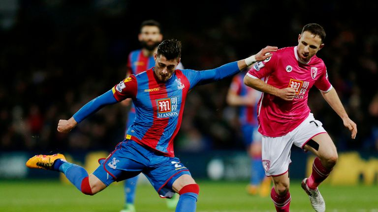 Crystal Palace's Joel Ward and Bournemouth's Marc Pugh battle for the ball during the game at Selhurst Park.